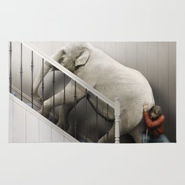 Pushing an elephant up the stairs Rug