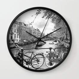 Bicycles parked on bridge over Amsterdam canal Wall Clock