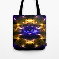 all seeing eye Tote Bags featuring All seeing eye by Cozmic Photos