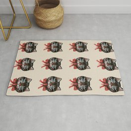 Cute Krampus cat face with red bow Rug