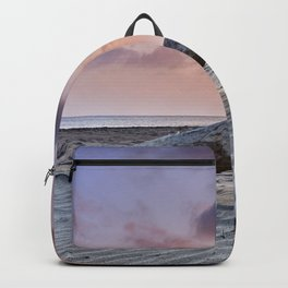 Half Moon Beach. Red sky Backpack