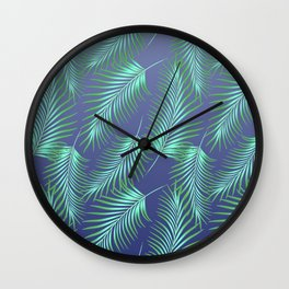 Palm leaves on blue background. Wall Clock
