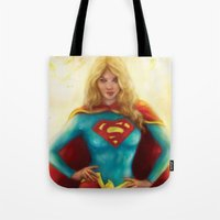 supergirl Tote Bags featuring Supergirl by SachsIllustration
