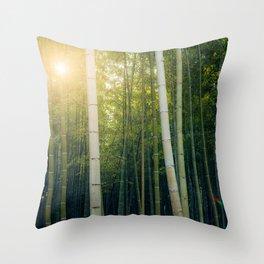 Sun shining through Arashiyama Bamboo Forest in Kyoto, Japan Throw Pillow