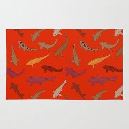 Koi carp. Brown orange yellow black outline on red background Rug