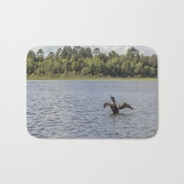 A Common Loon Fishing in the Summer Bath Mat
