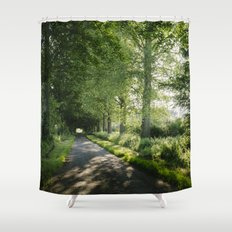 Sunlight through a remote country road lined with trees. Norfolk, UK. Shower Curtain