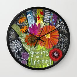 growing and learning Wall Clock