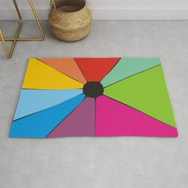 Colorful geometry with ink stsin in the center Rug