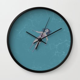Girl Floating in the Ocean Wall Clock