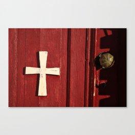 cross on a red door Canvas Print