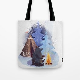 A teddy bear with a wigwam warms its paws by the fire in winter. Tote Bag