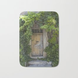 Provence Door covered with green vines Bath Mat