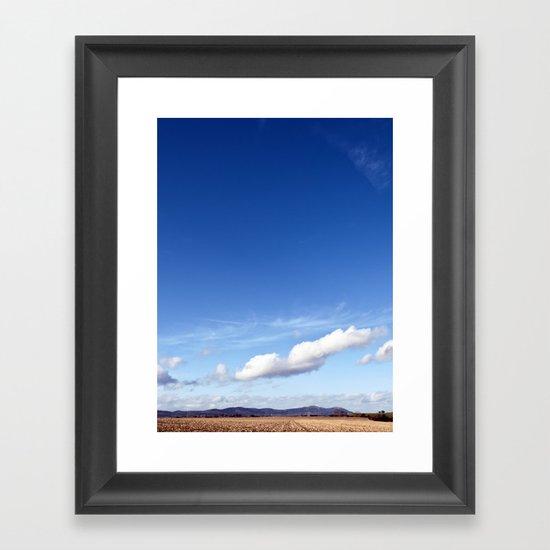 with a sky blue sky... Framed Art Print