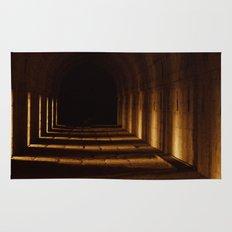 Tunnel in golden light Rug