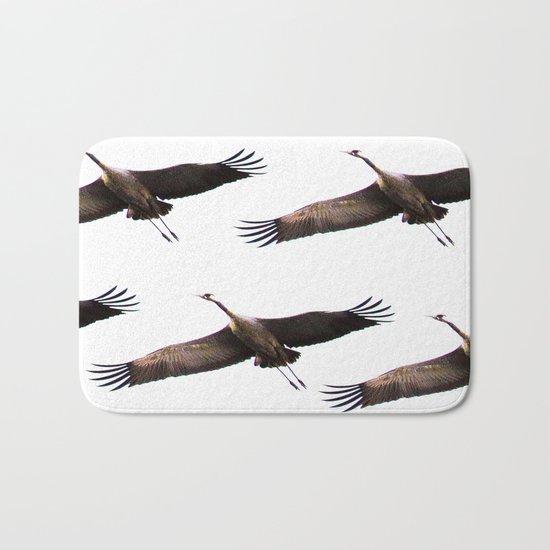 Cranes in flight Bath Mat