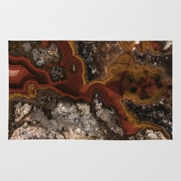 Twisted patterns of brown, red and beige stone Rug