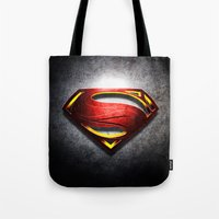 man of steel Tote Bags featuring Man of Steel by bimorecreative