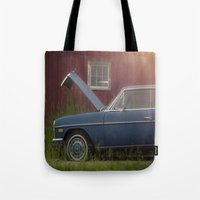 mercedes Tote Bags featuring Old blue Mercedes by Katie Jean Images