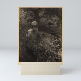 Doris Ulmann  (1882–1934), Girl kneeling behind bushes Mini Art Print