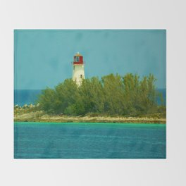 Lighthouse by the Ocean Throw Blanket