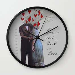love is real, real is love Wall Clock