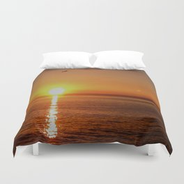 Ocean Flight with the Sun and Moon Duvet Cover