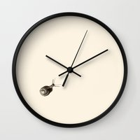 snail Wall Clocks featuring  Snail. by Assiyam