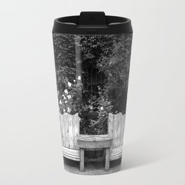 Wooden chairs and table in overgrown garden Travel Mug