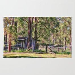 Old metal farm building in rural Queensland, Australia Rug