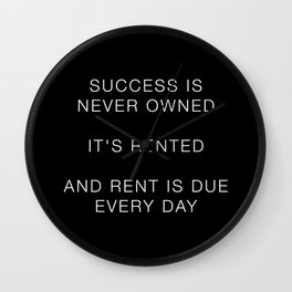Success is never owned Wall Clock