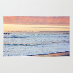 Vibrant Sunset over the Stacks at Huntington Beach, California Rug