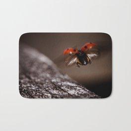 Ladybird in flight Bath Mat