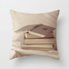 books in bed Throw Pillow