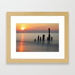 Groyne and sunset on the Baltic Sea coast Framed Art Print