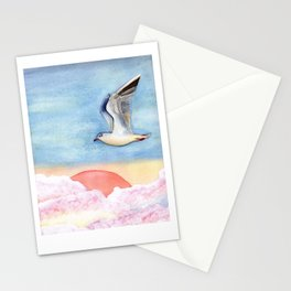 Seagull flying over pastel clouds Stationery Cards