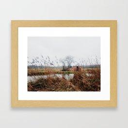 Riverside Hut Framed Art Print
