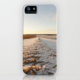 Ruts on a snow-covered road iPhone Case