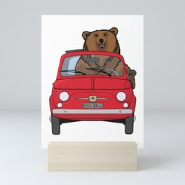 A bear driving a red vintage car Mini Art Print