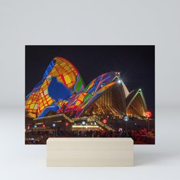 Designs projected on the roofs of Opera House. Mini Art Print