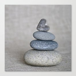 Balanced pebble stack with heart on top Canvas Print
