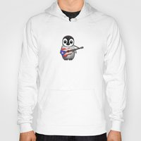 puerto rico Hoodies featuring Baby Penguin Playing Puerto Rican Flag Guitar by Jeff Bartels