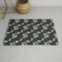 Green with pale pink anemones on a textural dark gray background Rug
