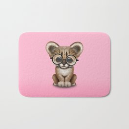 Cute Cougar Cub Wearing Reading Glasses on Pink Bath Mat