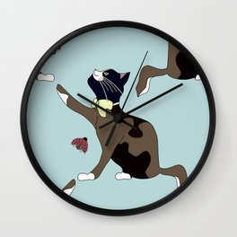 Cat with a bow catches a ladybug. Wall Clock