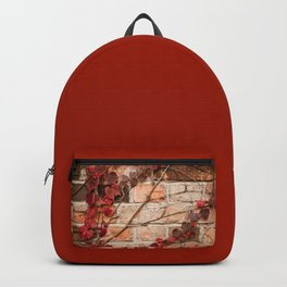 Red ivy leaves creeper on bricks wall Backpack