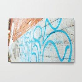 Blue graffiti on concrete wall Metal Print