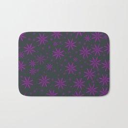 Purple flowers on black background Bath Mat
