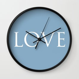 Love word on placid blue background Wall Clock