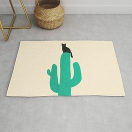 Cat on cactus Rug